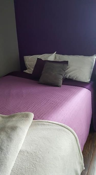 purple comforter multiple pillows