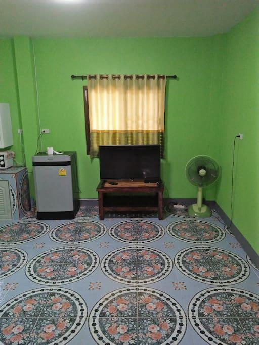 Living area, TV and refrigerator