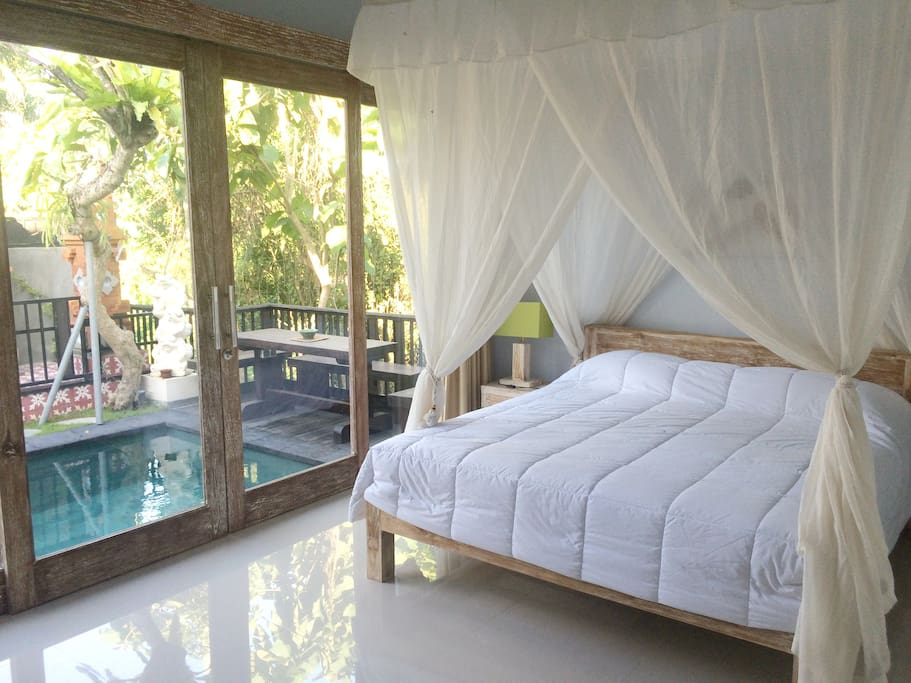 bedroom overloking pool