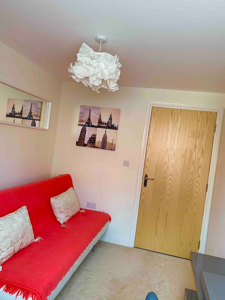 Bright, cosy room with a double sofa bed