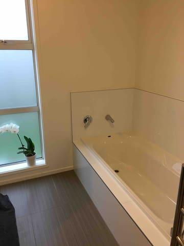 Bath in shared bathroom.