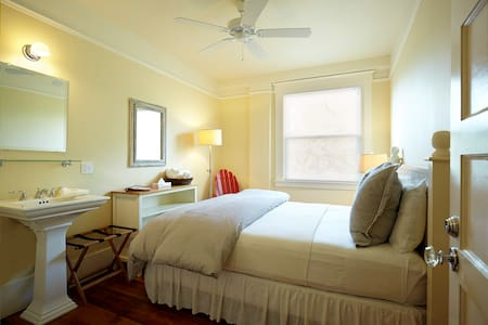 Room with Queen Bed & personal sink