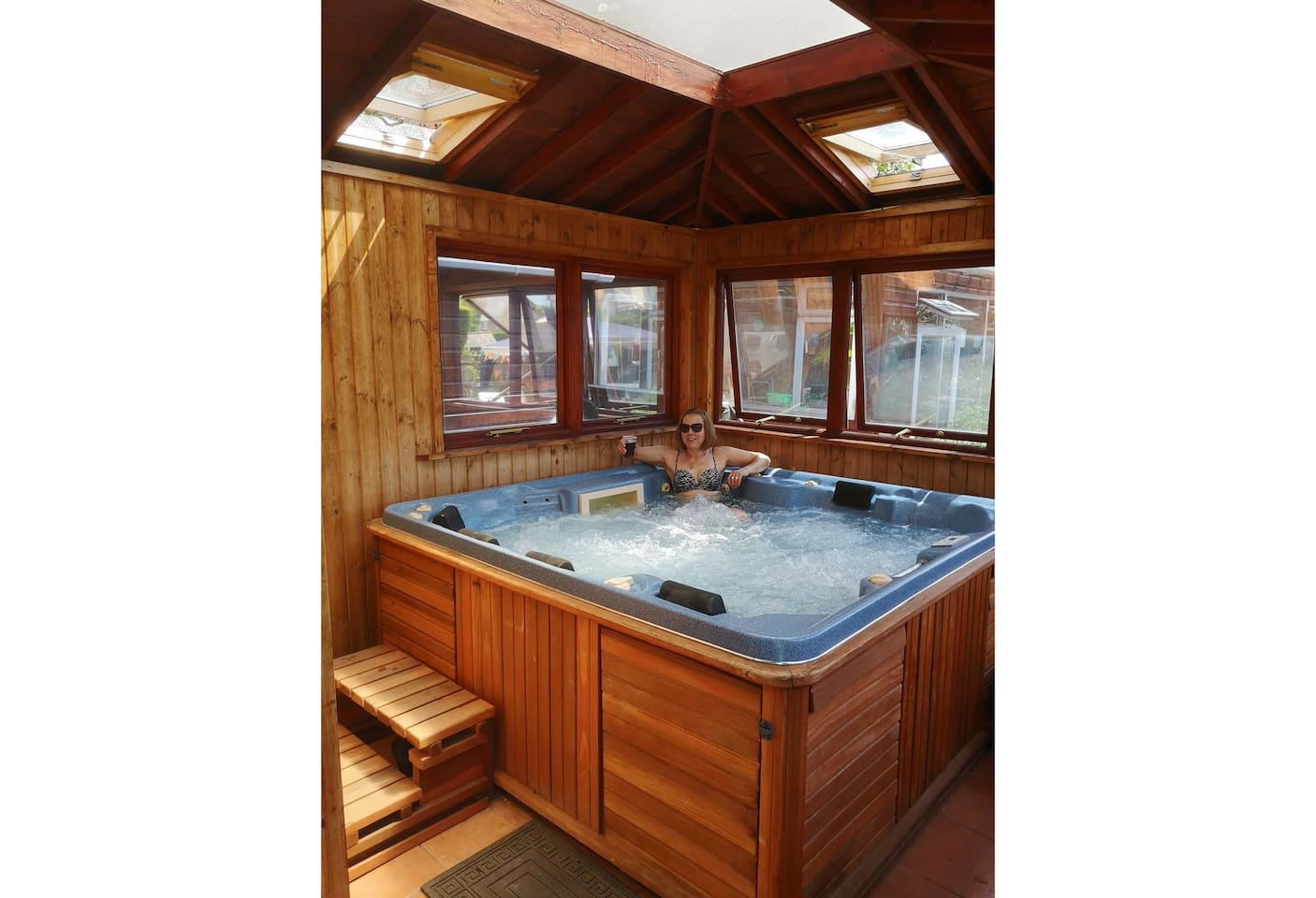 Inside the Hot tub cabin, with blue tooth speaker and LED colour changing lights. Secluded and private.