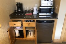 A complete mini-kitchen in your room. Fridge, microwave, toaster oven, Keurig machine, & kettle. Wine glasses, coffee cups, plastic glasses, cutting board, wine opener, plates, bowls, silverware, ice bucket, TV tray…we've thought of everything.