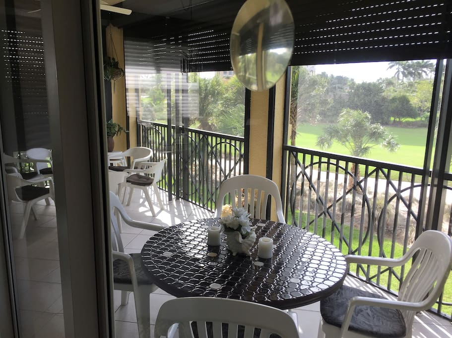 View through the Living Room Lanai sliding door to the 3rd hole of Hammock Bay Golf Club