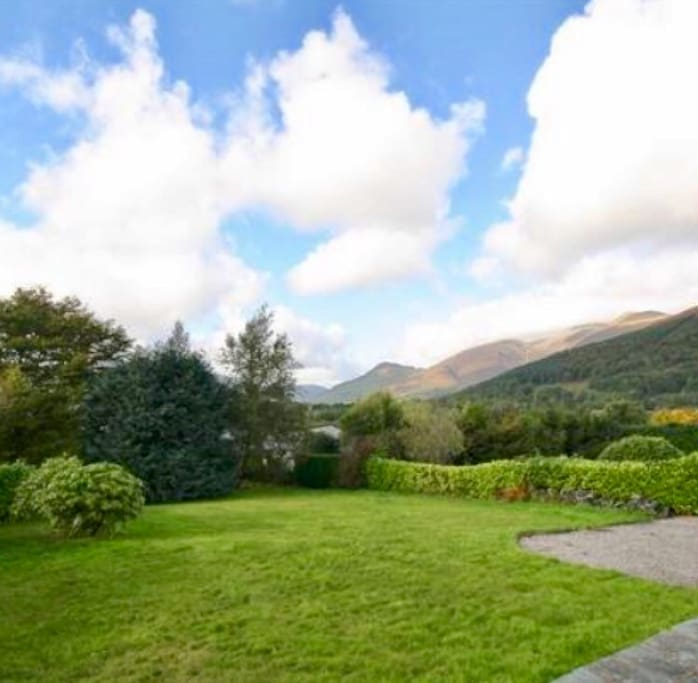 Large front garden and terrace. Panaramic views over the fells, bass lake and keswick.
