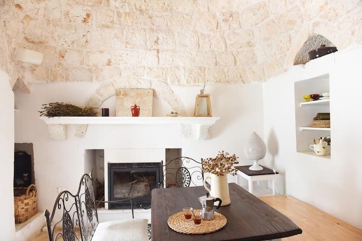 The fireplace in the trullo.
