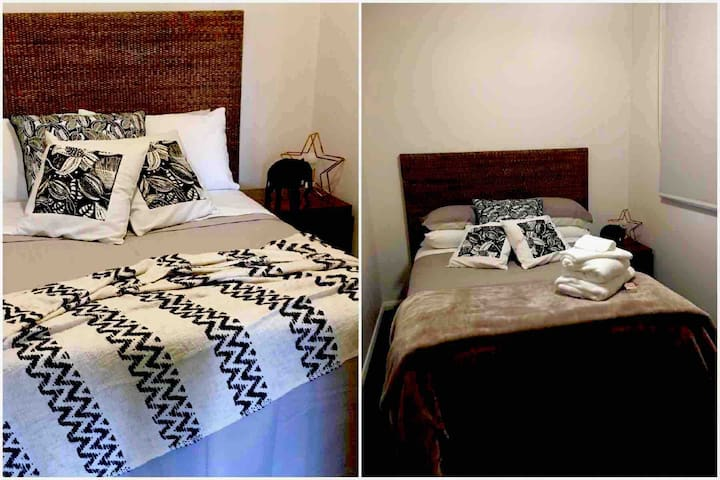 Bedroom 3 - the cute one. A comfy double bed with a woven rattan behead, nice linen, plenty of pillows, hanging hooks, a small built in wardrobe, a ceiling fan to keep you cool and a heater to keep you warm.