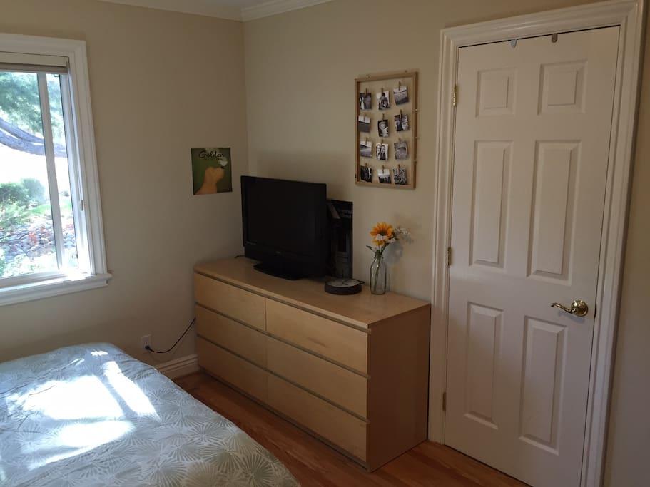 Dresser, closet, flatscreen TV