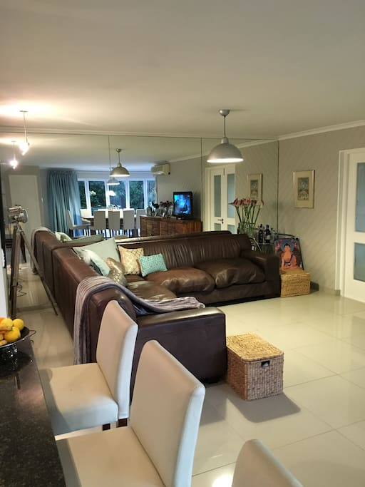 Open plan living and dining areas off the kitchen lead onto outside entertainment area and pool