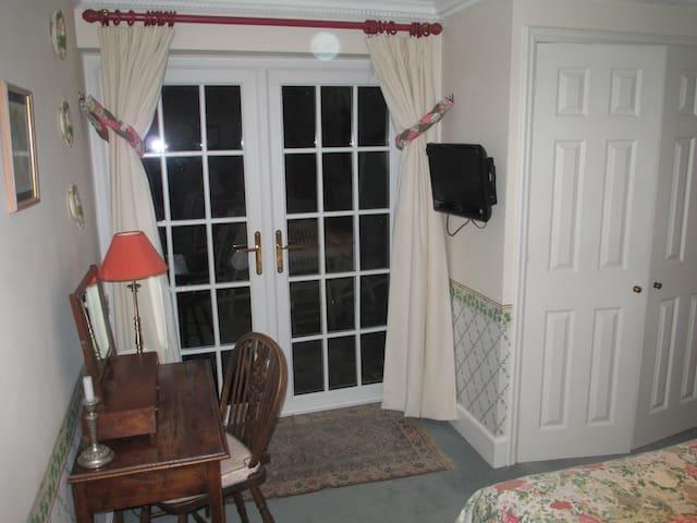 Door to patio from bedroom