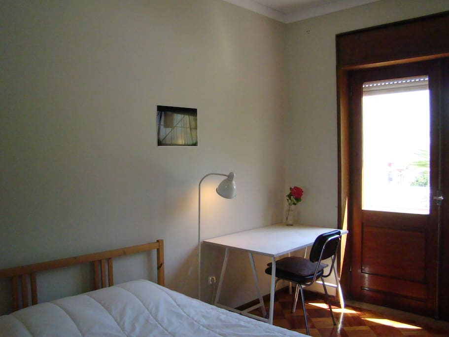 Room with double bed & balcony facing south