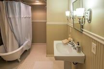 Lower level full bath with claw foot tub