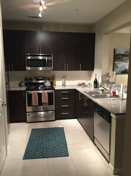 Full kitchen with upgraded amenities and granite counters.