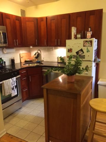 The kitchen features a full size range, microwave, dishwasher, and refrigerator/freezer.