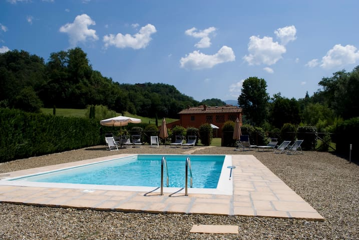 Villa and outbuilding, fenced lawn, pool and sauna