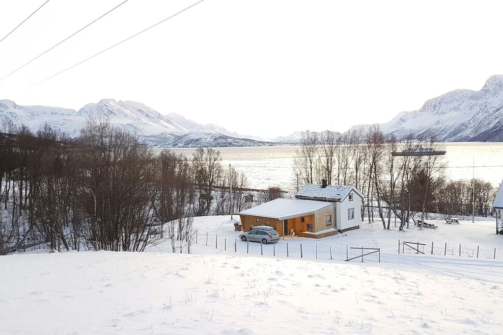 The cabin and view southwards across Ulsfjorden