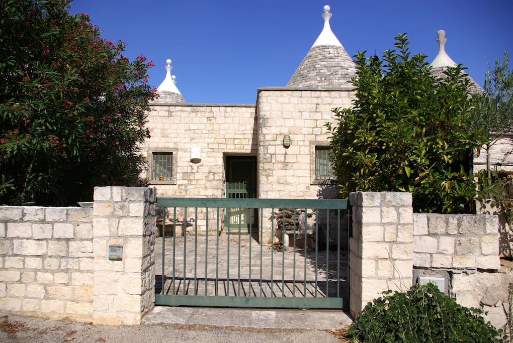The backyard entrance to the Trullo with private parking (1 car)