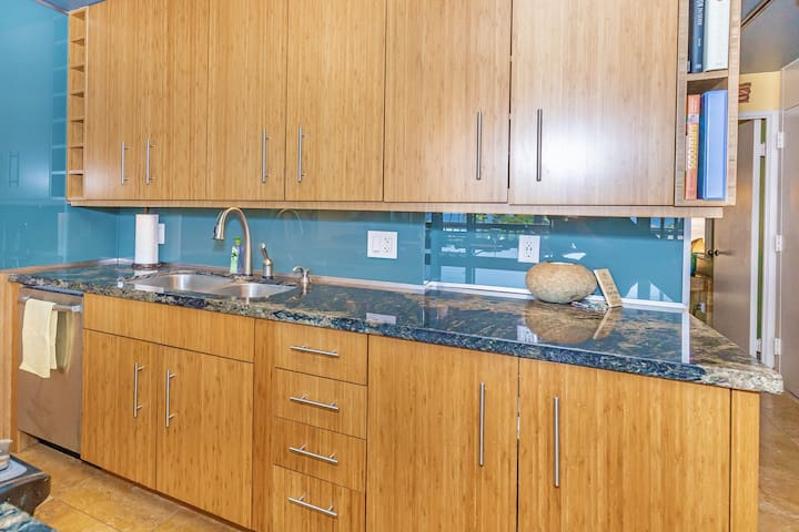 Kitchen features granite countertops, built-in cooktop and stove, dishwasher, refrigerator