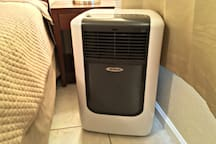 Bedroom has an air conditioner unit for your comfort