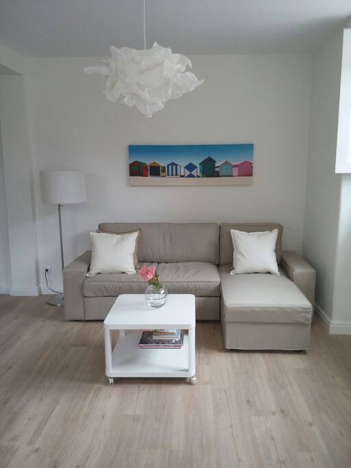 Lounge Area with coffee table & TV