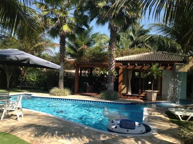 Vila com jardim em condomínio praia do Pernambuco