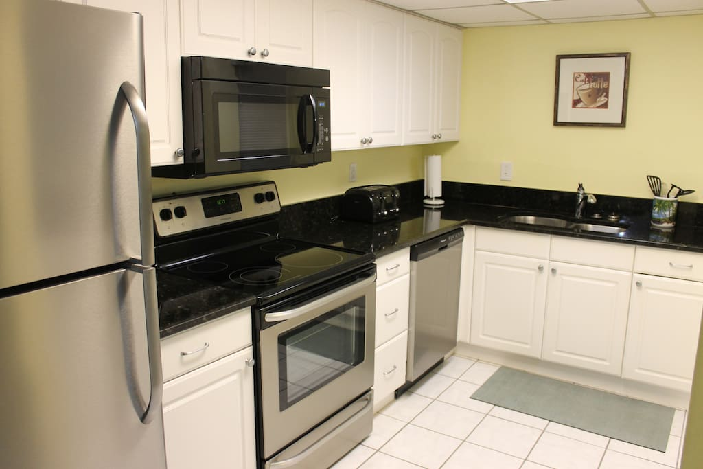 Bright, updated kitchen with granite counter tops and new stainless steel appliances