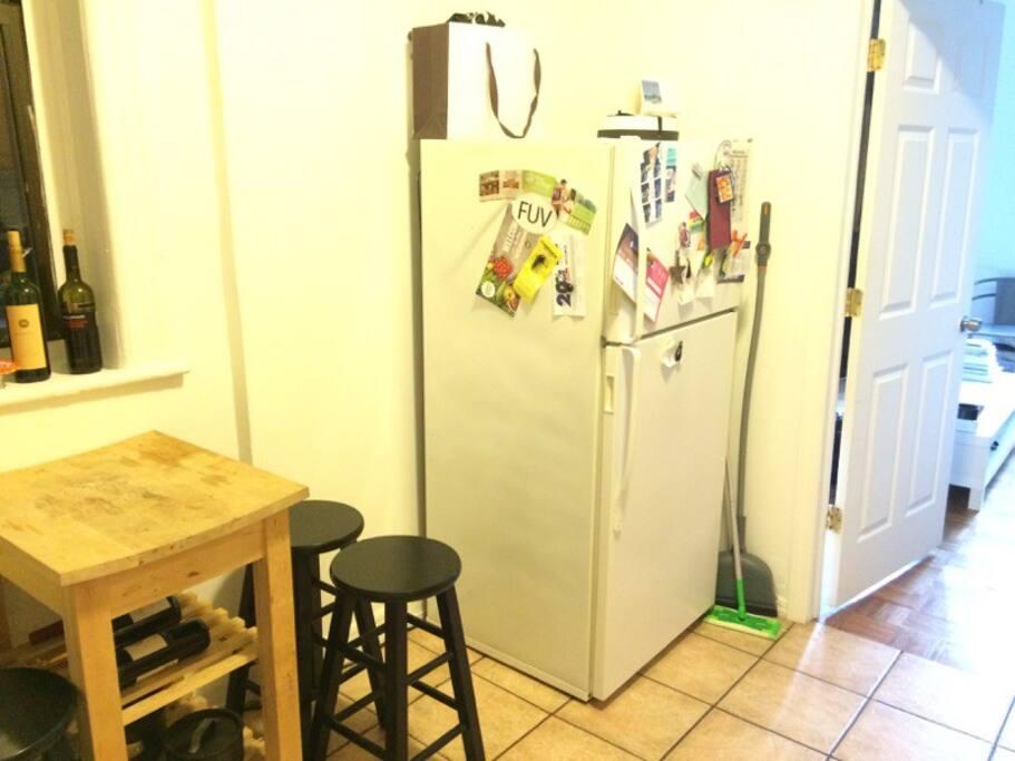 Door separates living area from kitchen