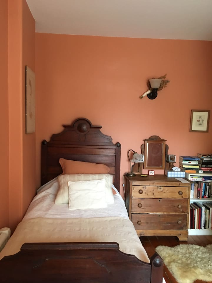 Cosy single bed in bright room