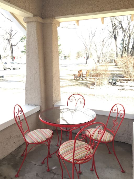 Outdoor seating for four on the front porch