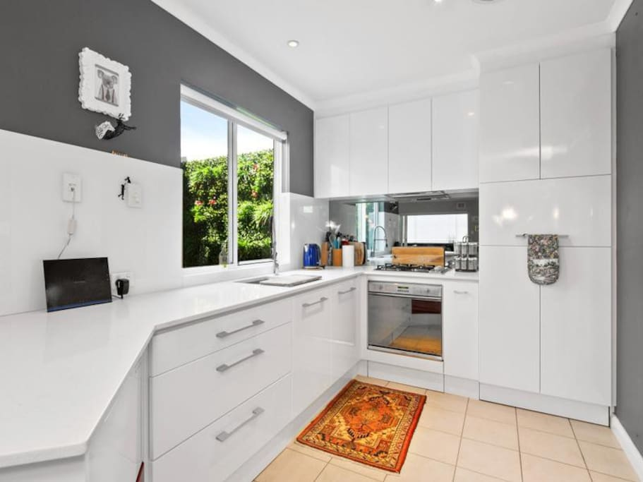 Big kitchen with dishwasher, oven and stove