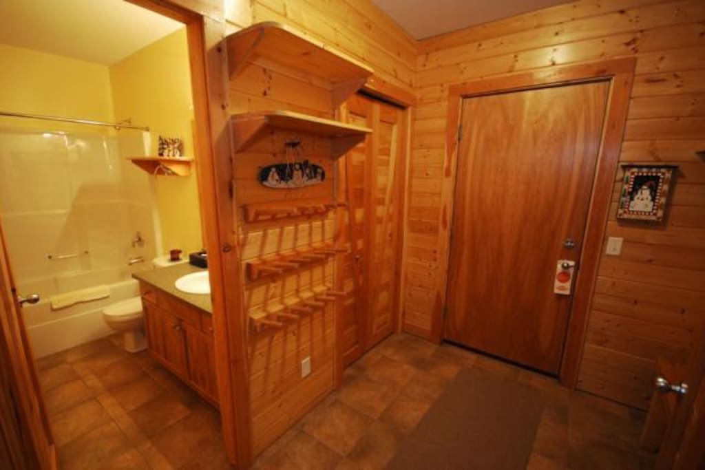 Large entry to the condo with a lot of storage for gear, main bathroom of off this entryway