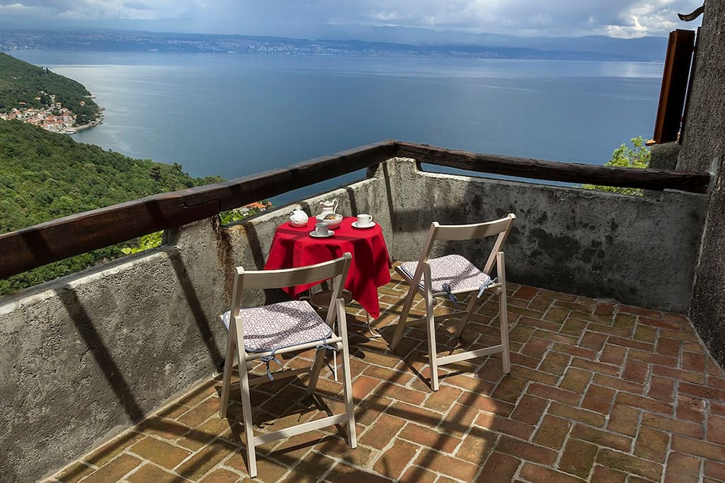 Private upstairs balcony with a stunning view is perfect for breakfasts or afternoon coffee.