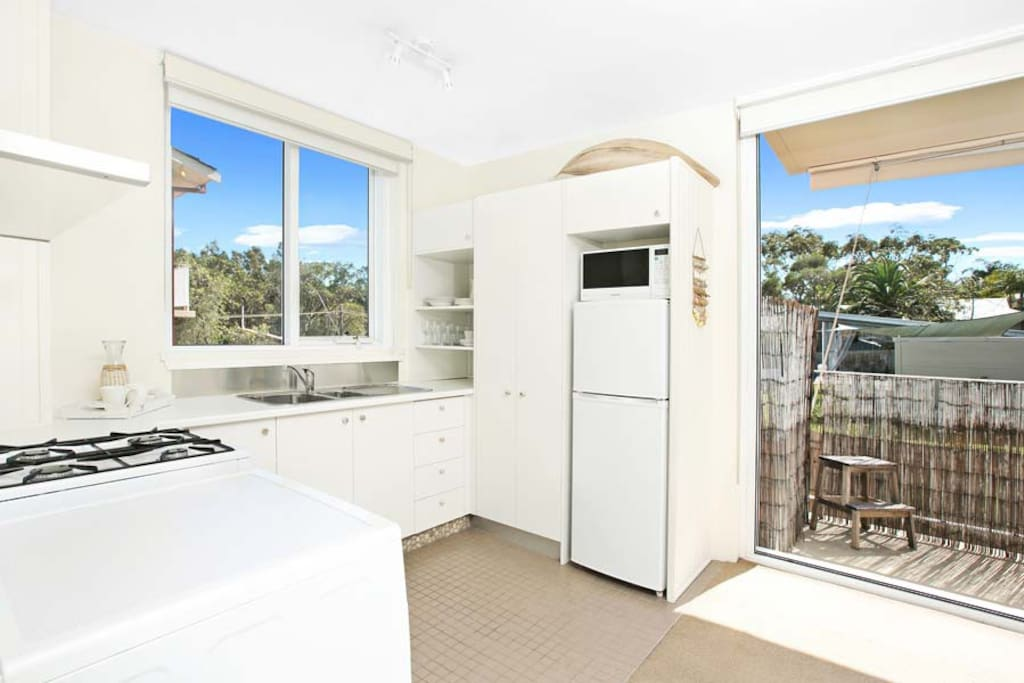 Delightful kitchen with oven, cooktop, fridge, microwave and every tool you'll need to cook.