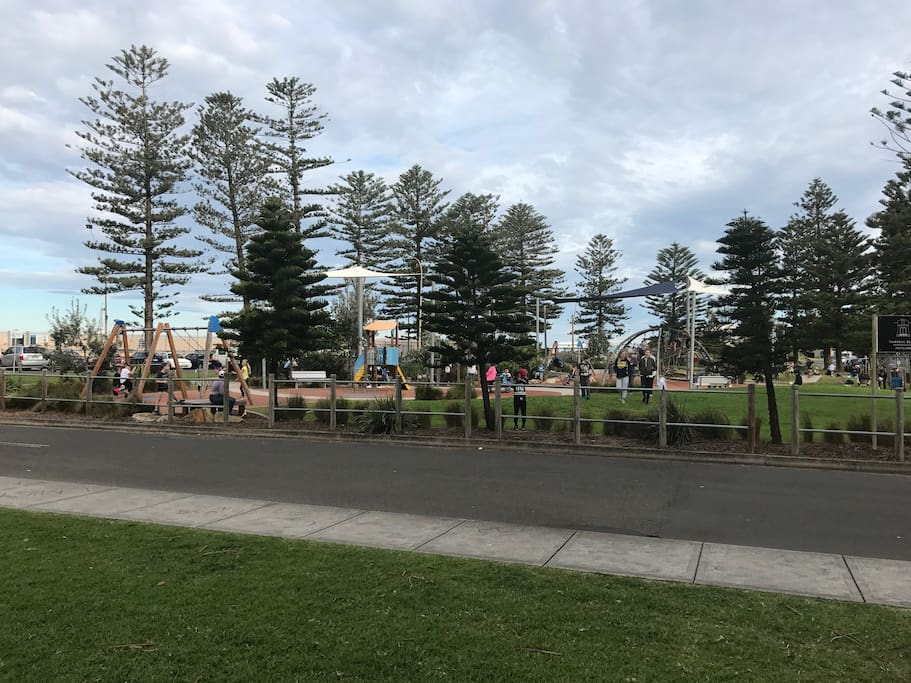The park separates you from the beach it has all the play equipment that kids love