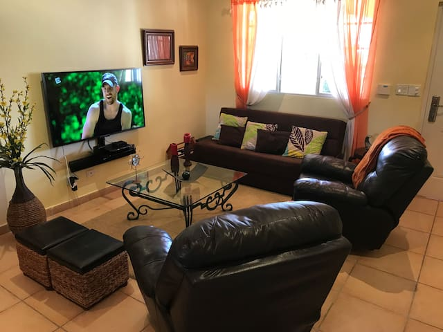 """Living Room, 2 Recliner Chairs, a full size sofa bed, 3D Smart TV, Sound bar and Bluray. Amazon Alexa with the """"all new"""" Fire TV Cube."""