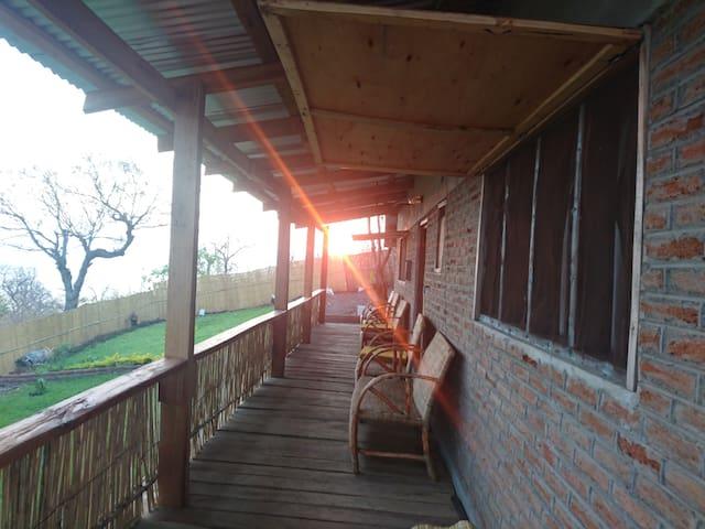 Enjoying sunrise and sunset over Lake Malawi sitting on the deck
