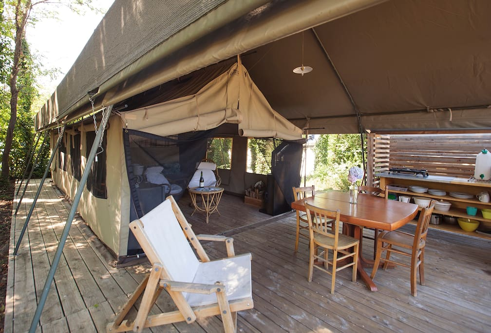 Tent awning and exterior terrace and kitchen