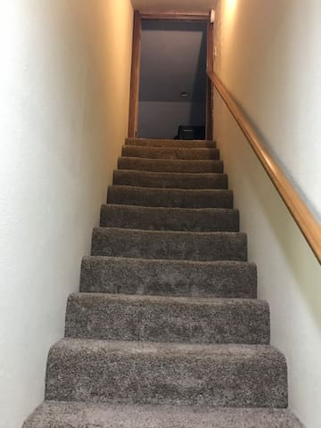 Stairs to bedroom and living room