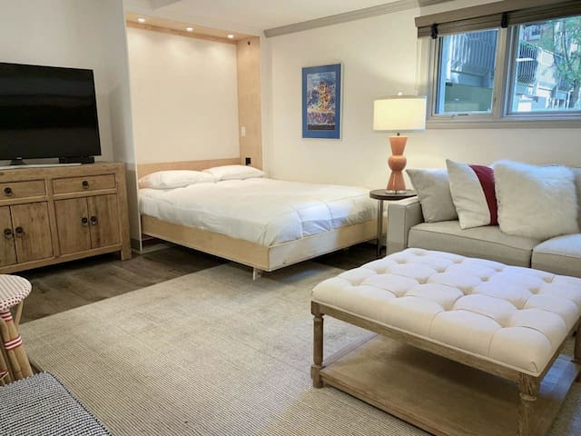 This queen-sized murphy bed offers top-notch comfort with hotel-quality linens.  Stow it in the wall for extra space and convenience.  Much better than a sleeper sofa! The large sectional couch also has a pull-out full-sized bed, if desired.