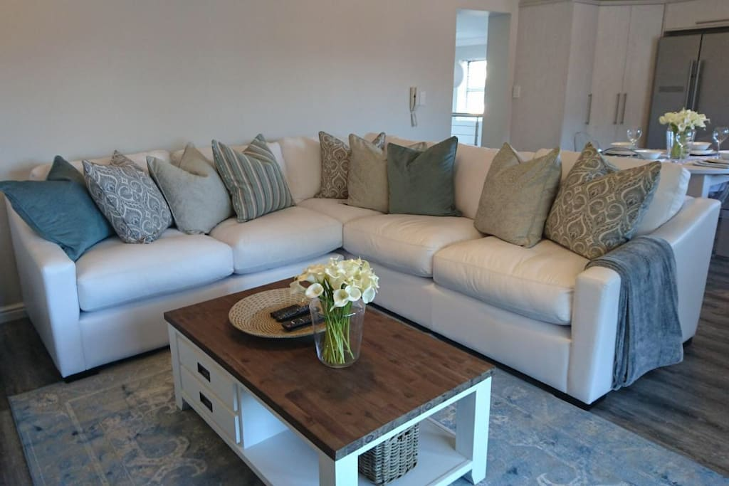 Open plan lounge leading to spacious patio -  lots of comfy seating in and out of the house