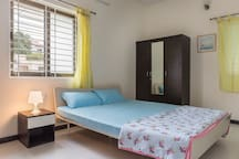 Queensize bed with fresh air and plenty of light