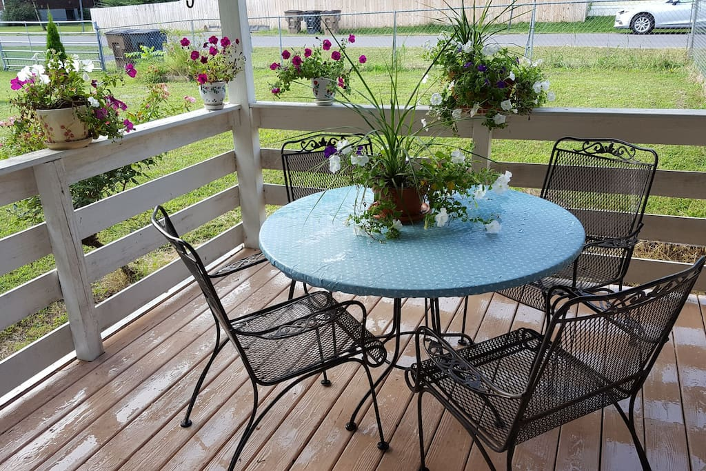 My favorite place to sit around the table, breathe fresh air and enjoy the morning sunshine.