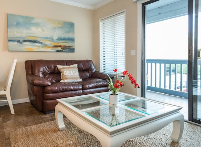 Living Room with Comfy Leather Couch & Tile Floors