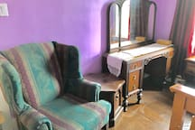 Antique vanity and a comfy armchair