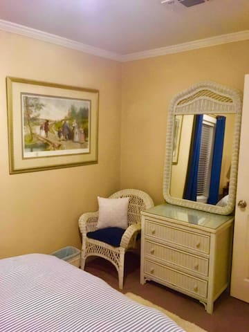 Dresser for holding travel bags. 3 drawers and a closet are available for clothes for those who stay a little longer.