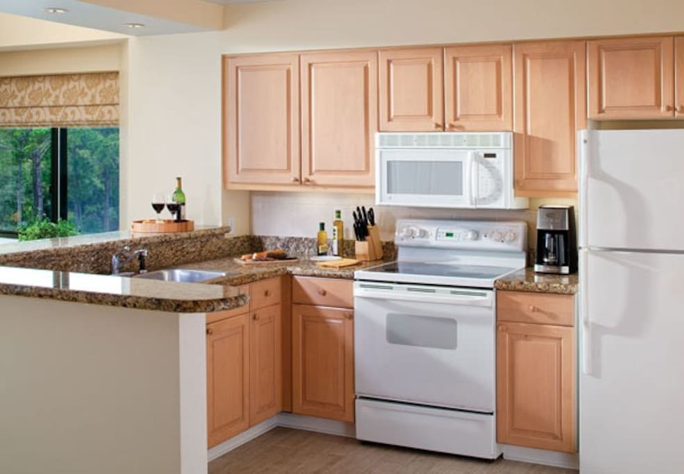 Convenient and fully-furnished kitchen.