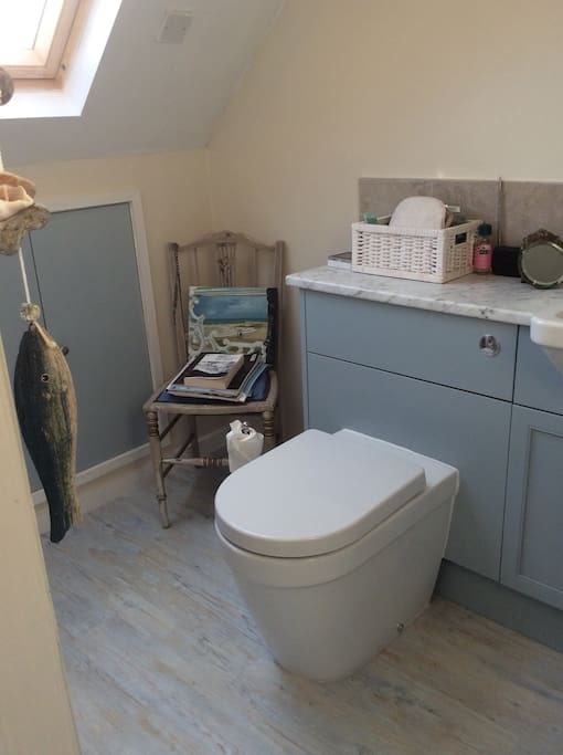 Upstairs bathroom with bath/shower.