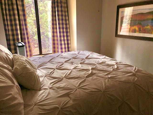 One of our main floor bedrooms, no stairs required. Queen bed.