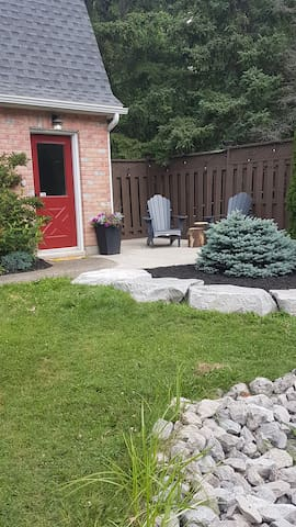 Private entrance with patio overlooking the pond